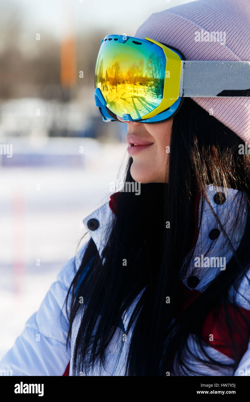 Brunette in sunglasses at mountains - Stock Image