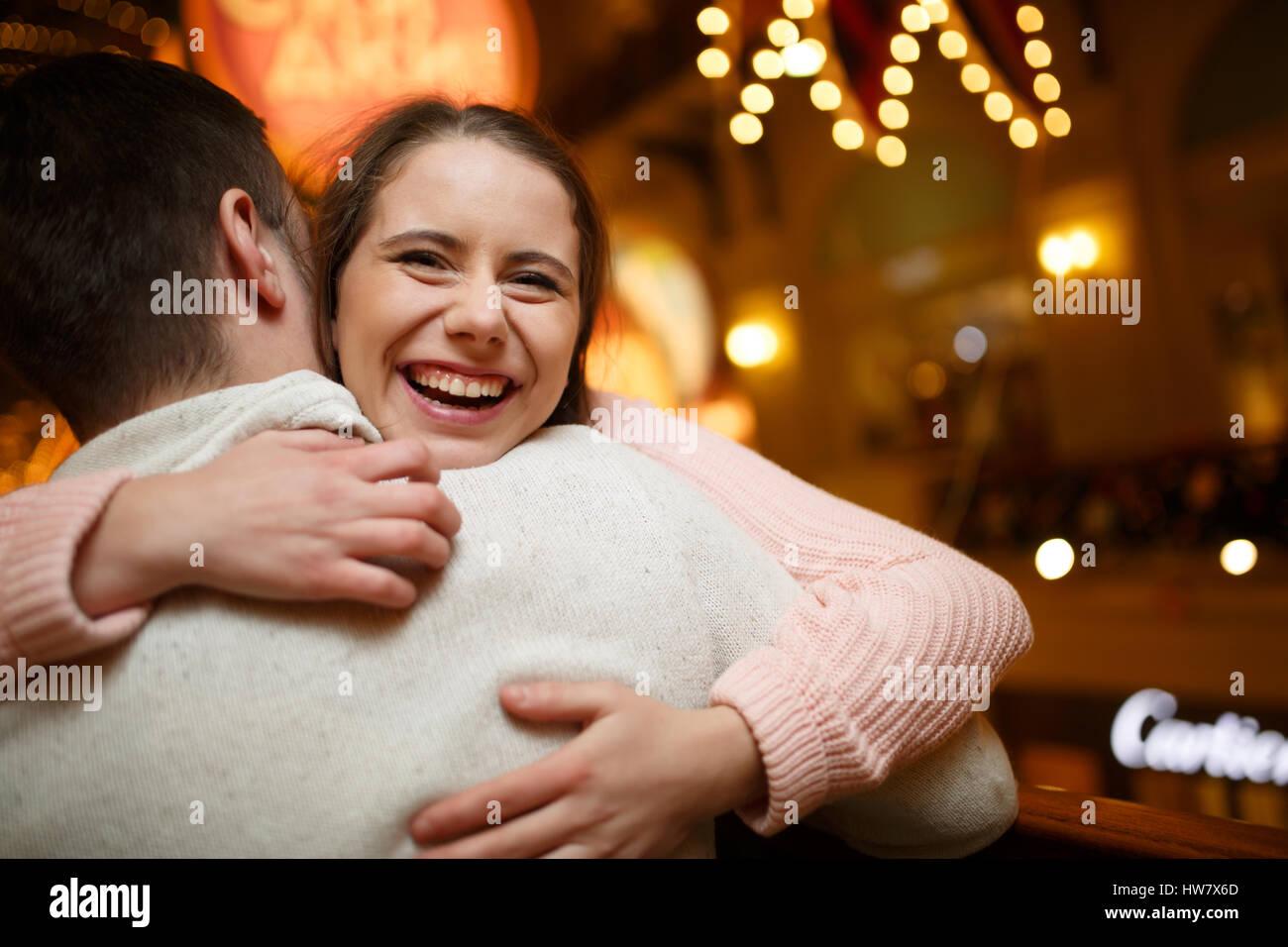 Laughing pair at shopping mall - Stock Image
