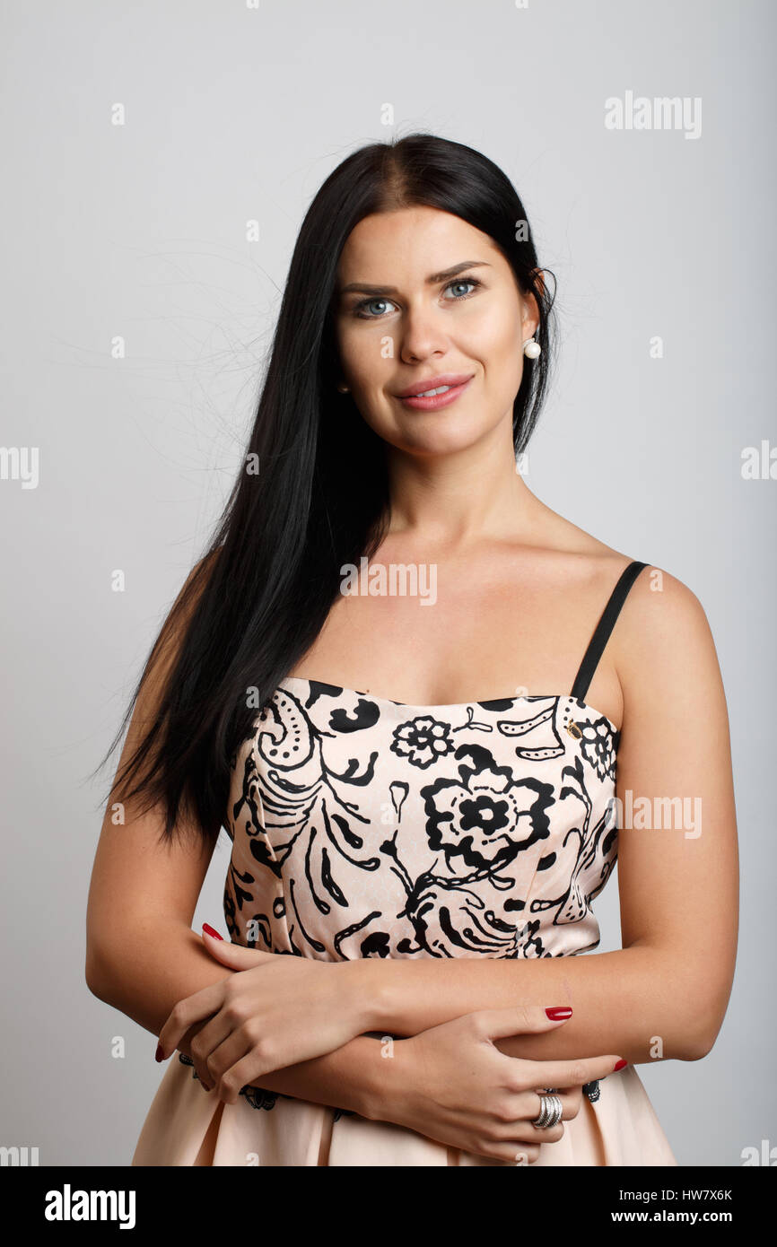 Smiling model with long hair - Stock Image