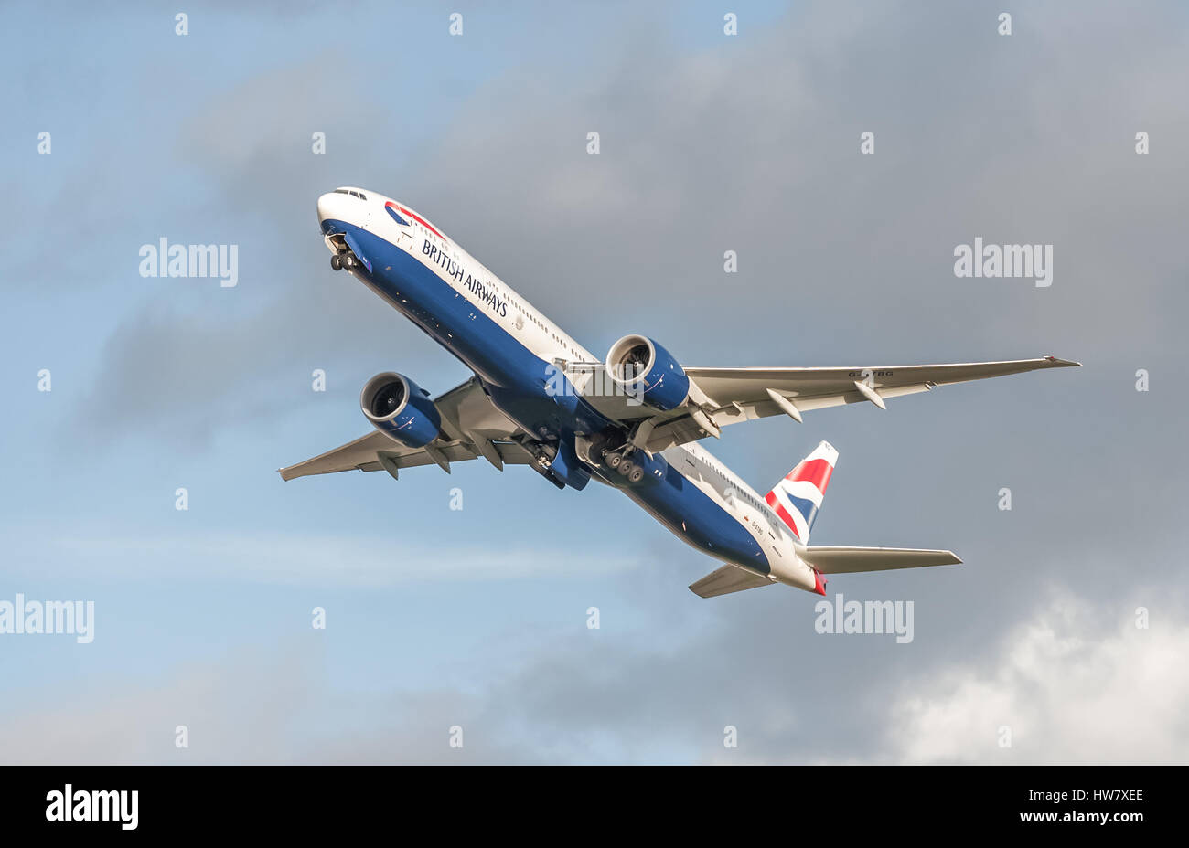 British Airways Boeing 777 retracting its undercarriage on take-off from Heathrow Airport, London, UK - Stock Image