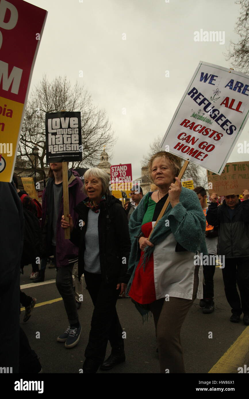 London, UK, 18th March 2017.Two women hold up placards as campaign group Stand Up to Racism holds a march through Stock Photo