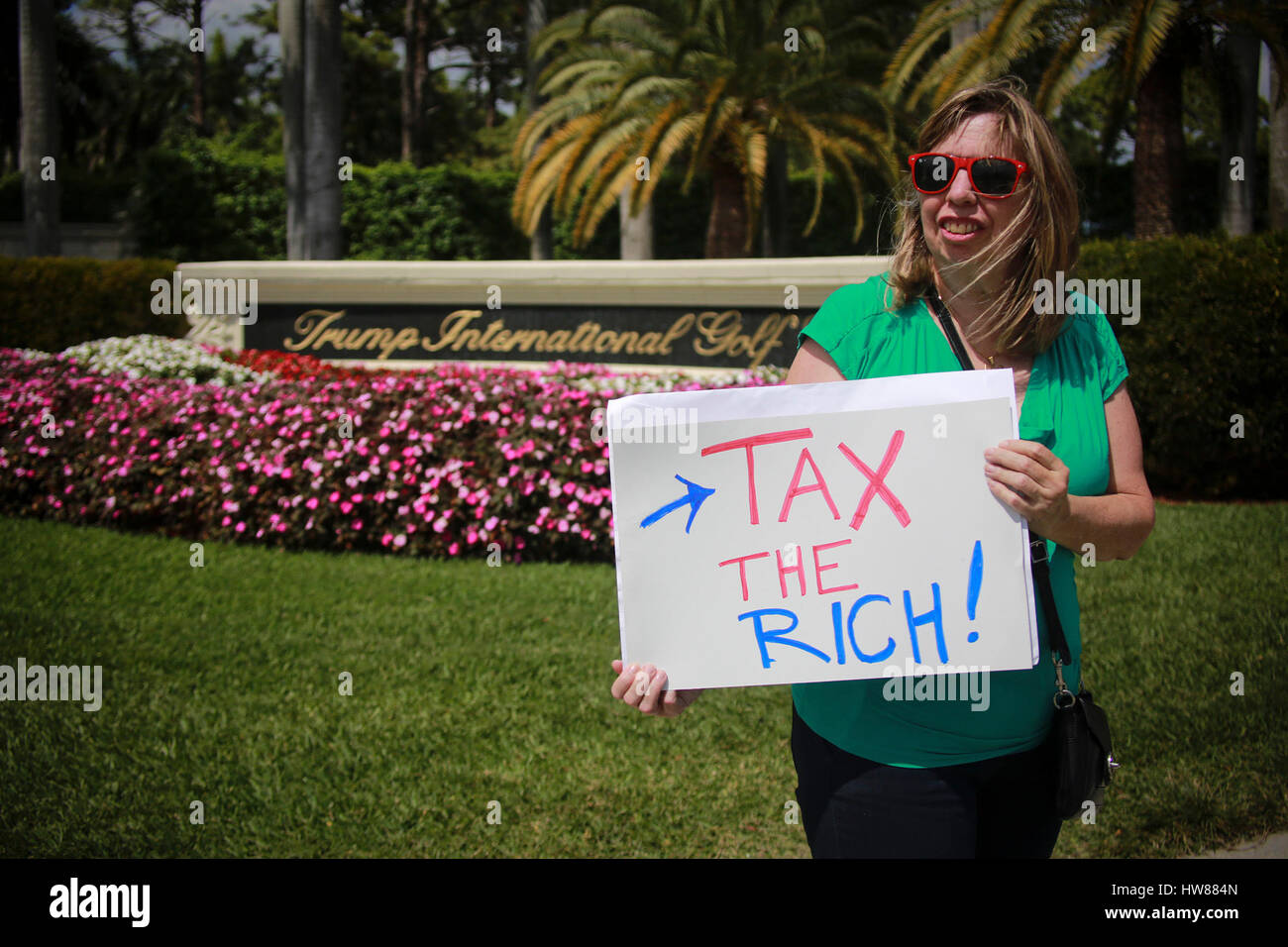 March 18, 2017 - Florida, U.S. - Mary Jane Zapp of West Palm Beach protests outside Trump International Golf Club - Stock Image