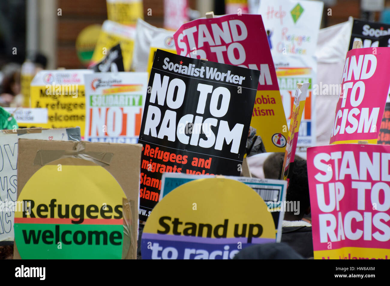 London, UK. 18th March 2017. Thousands of protesters march through central London protesting Against Racism on UN - Stock Image