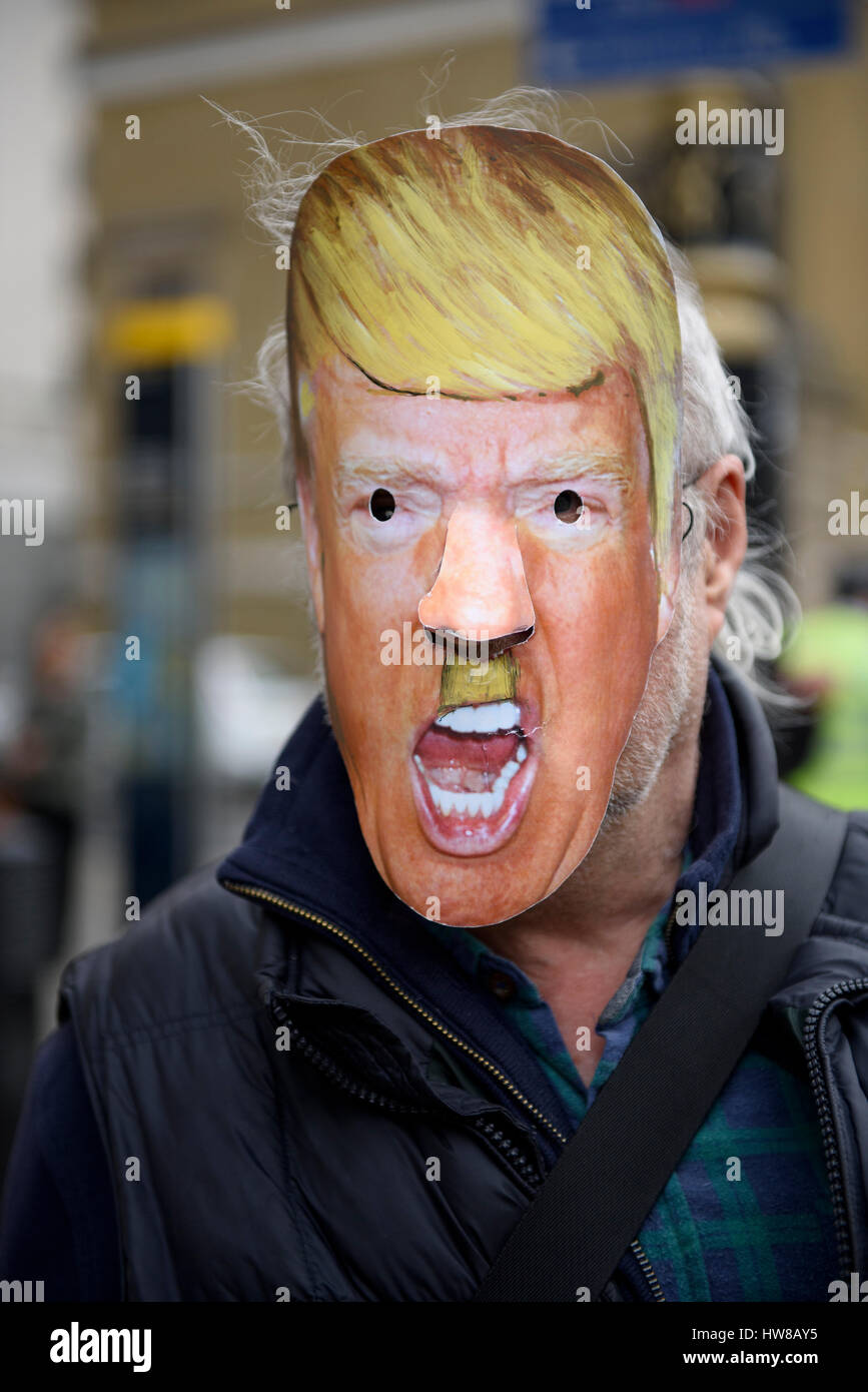 London, UK. 18th March 2017. Anti-racism protester is wearing a Hitler-Trump mask during the UN International Anti - Stock Image