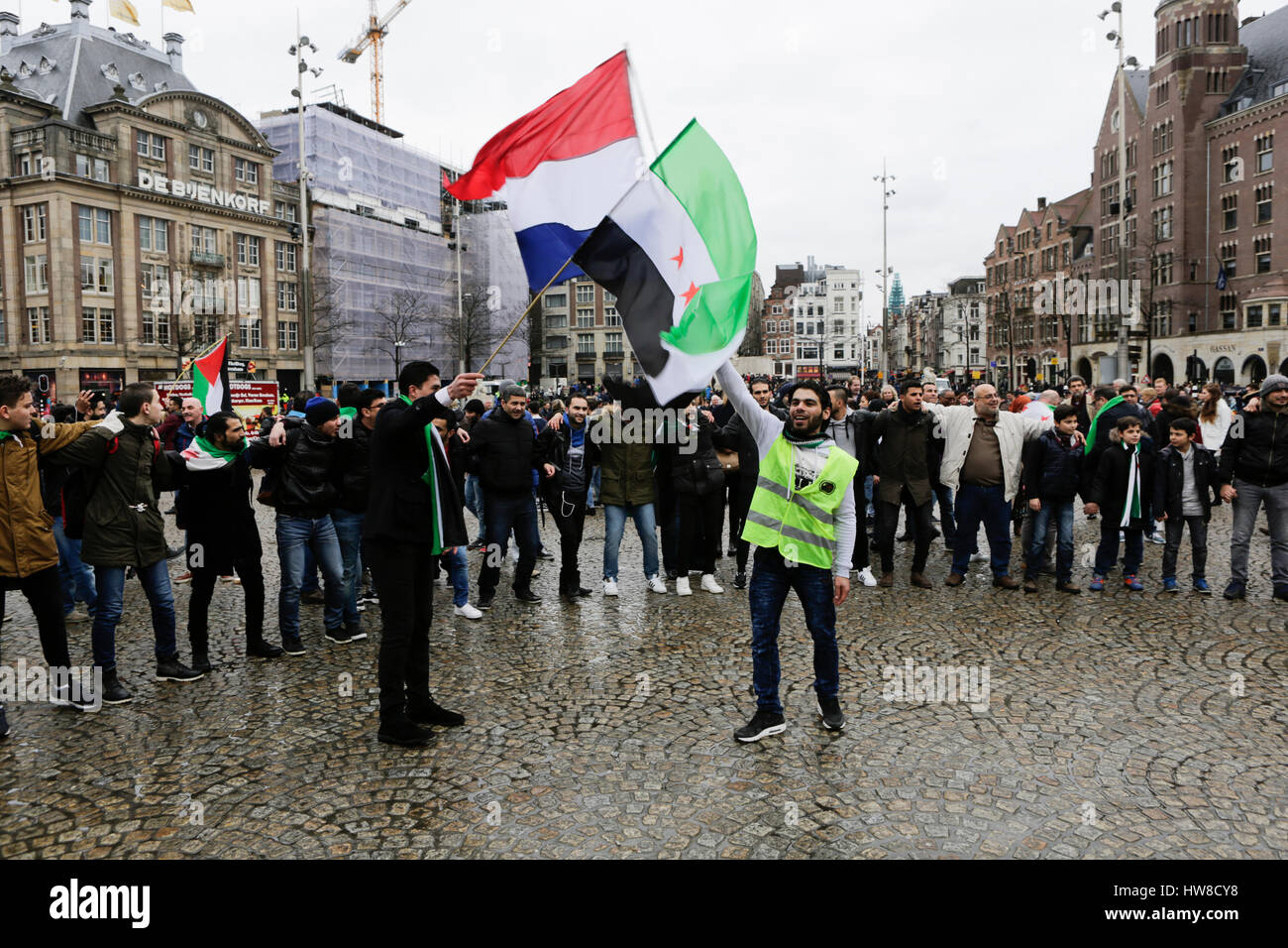 Two Syrians wave a Dutch and a Syria Independence flag. Syrians living in Amsterdam celebrated the 6th  anniversary Stock Photo