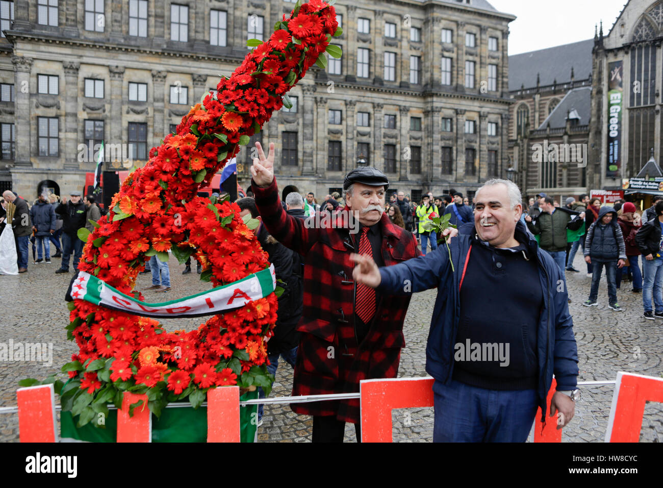 Syrians pose at a number 6 made from flowers. Syrians living in Amsterdam celebrated the 6th  anniversary of the Stock Photo