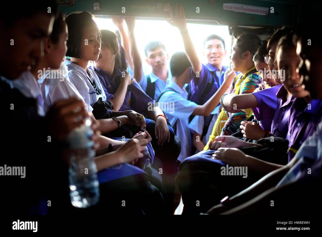 Thailand, Sukhothai Province, Sukhothai, students go to school in a songthaew, a collective taxi mainly used in - Stock Image
