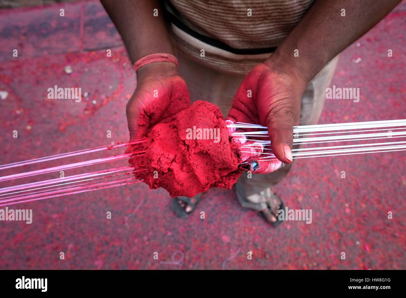 India, Gujarat State, Ahmedabad, listed as World Heritage by UNESCO, dyeing cloth in the street Stock Photo
