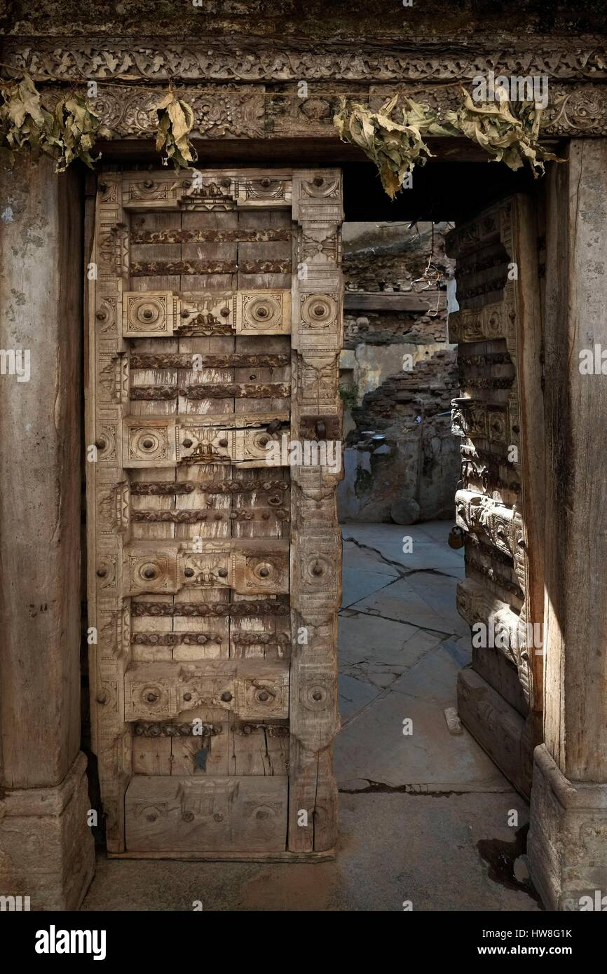 India, Gujarat State, Ahmedabad, listed as World Heritage by UNESCO, carved wooden doors from havelis of Ahmedabad, - Stock Image