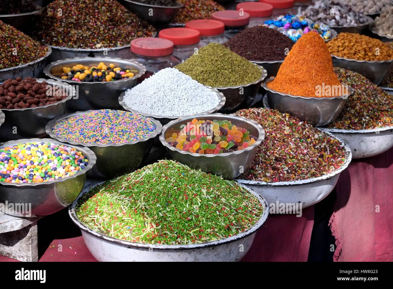 India, Gujarat State, Ahmedabad, listed as World Heritage by UNESCO, bowls of spices and sweets on an Indian market - Stock Image