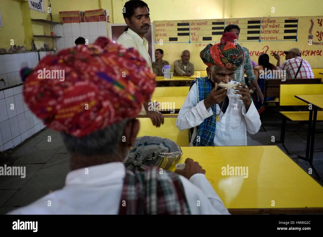 India, Gujarat State, Ahmedabad, listed as World Heritage by UNESCO, two men in turbans in the restaurant of a bus - Stock Image