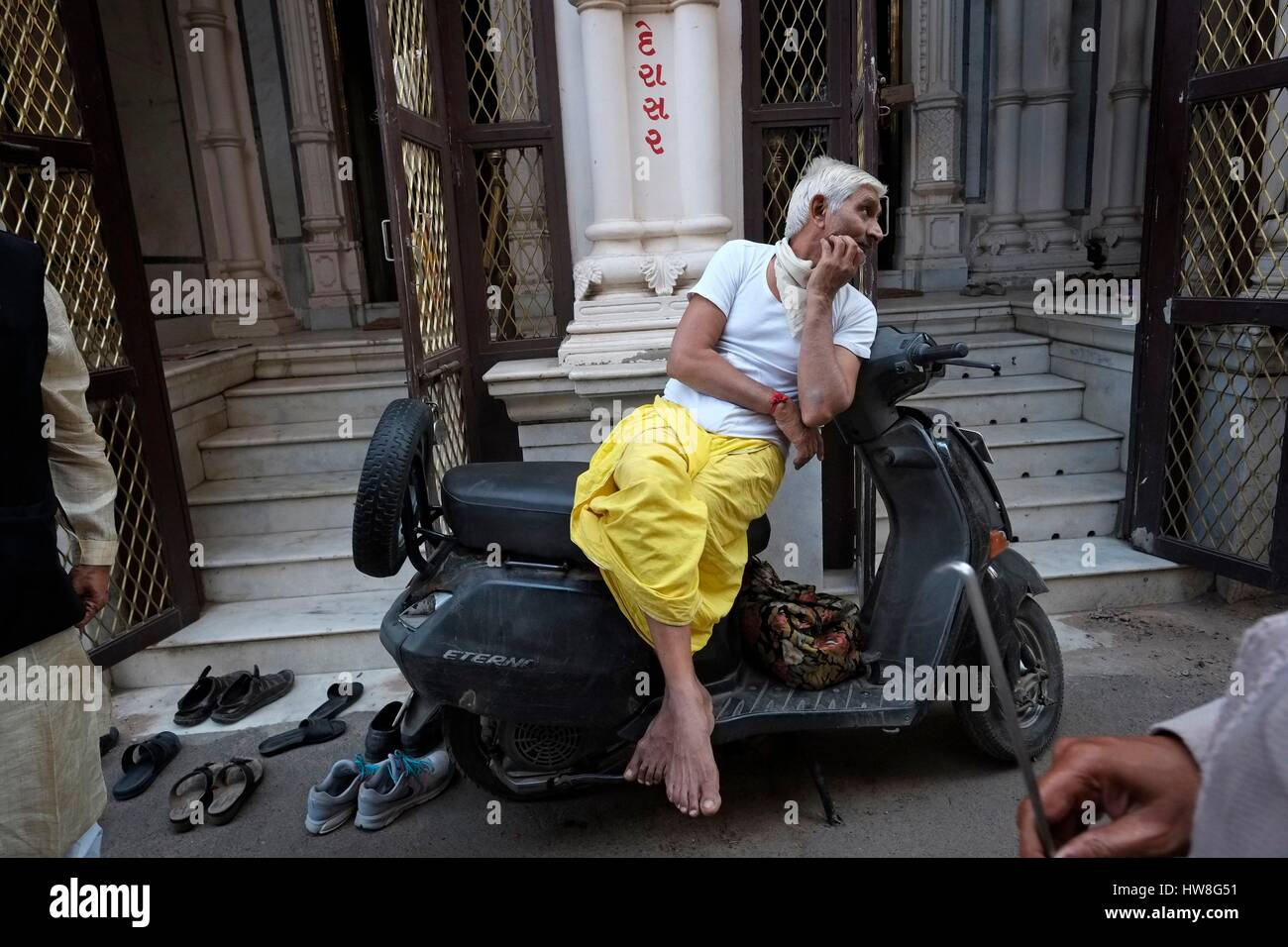 India, Gujarat State, Ahmedabad, listed as World Heritage by UNESCO, daily life in front of a Jain temple in the - Stock Image