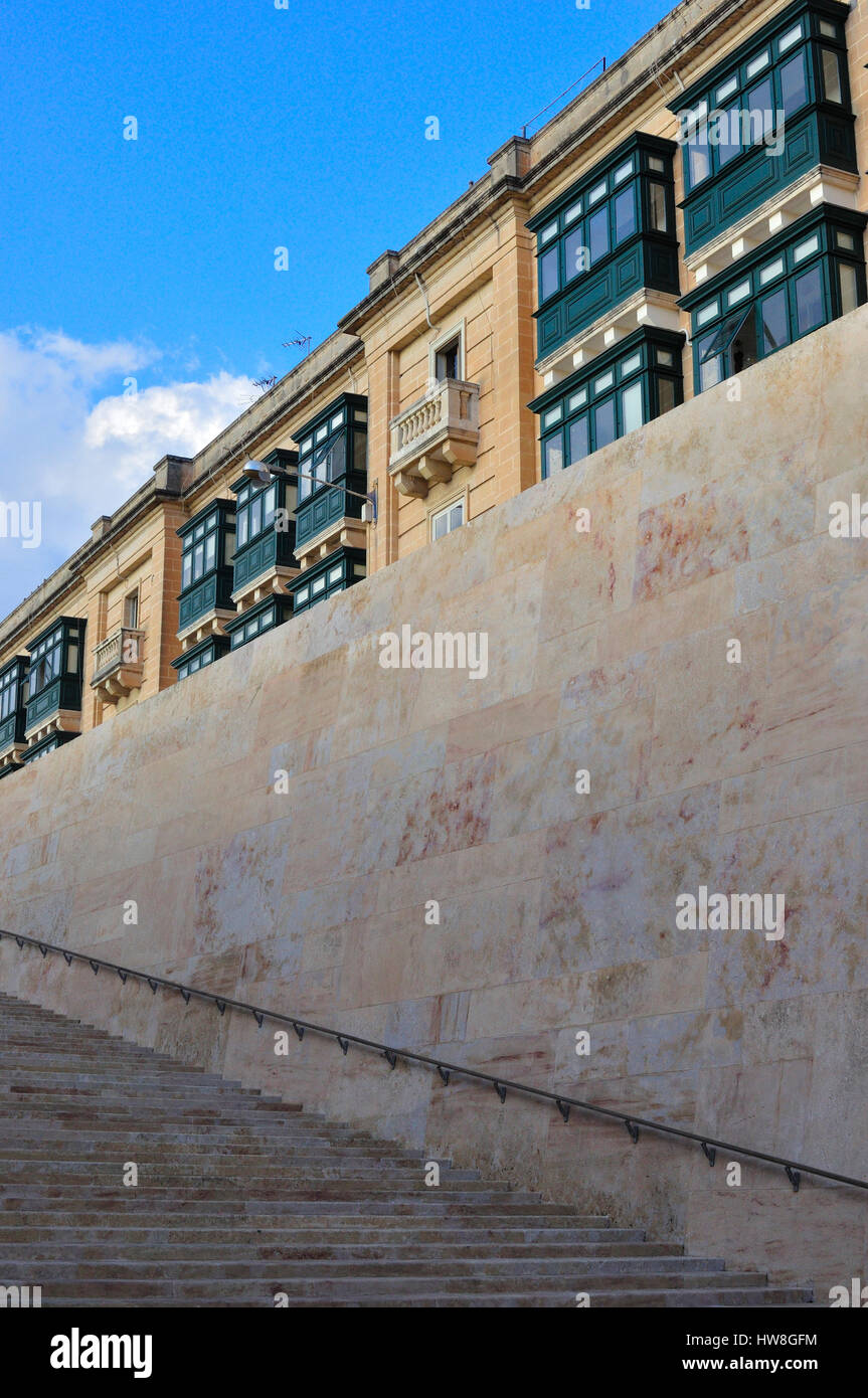 traditional Maltese buildings at the entrance to Valletta, with enclosed Ottoman style balconies - Stock Image