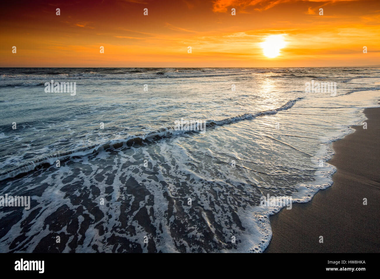 Beach at sunset, Marbella. Malaga province. Costa del Sol, Andalusia Southern Spain.Europe - Stock Image