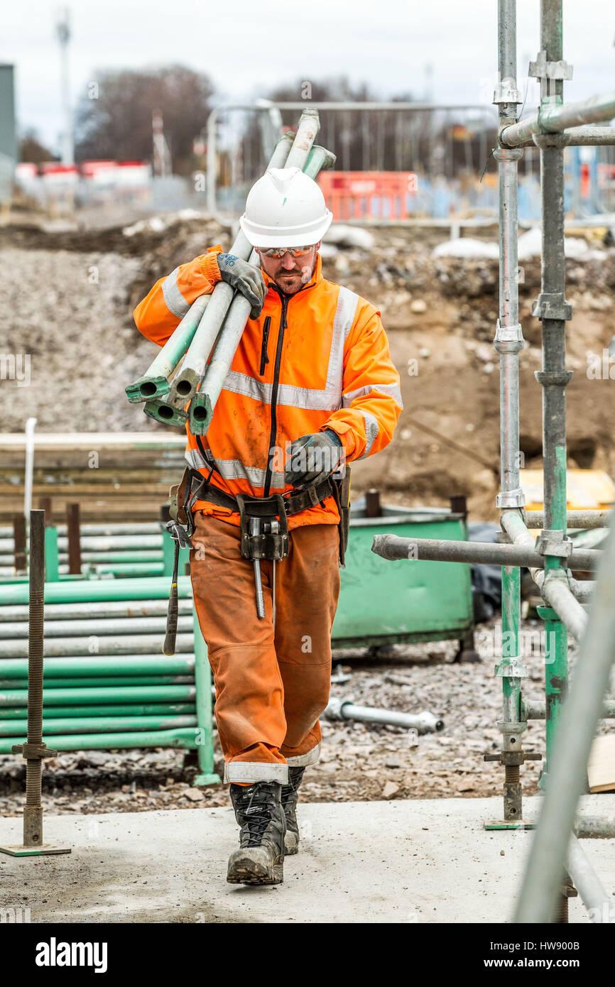 Scaffolders constructing scaffold  Scaffolders at work - Stock Image
