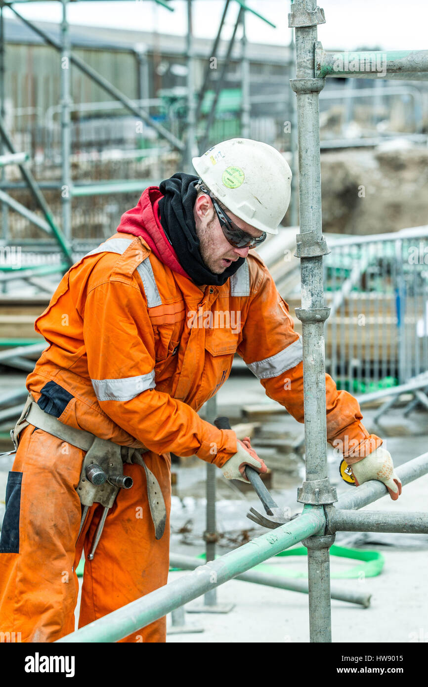 Scaffolders constructing scaffold  Scaffolders at work - Stock Image