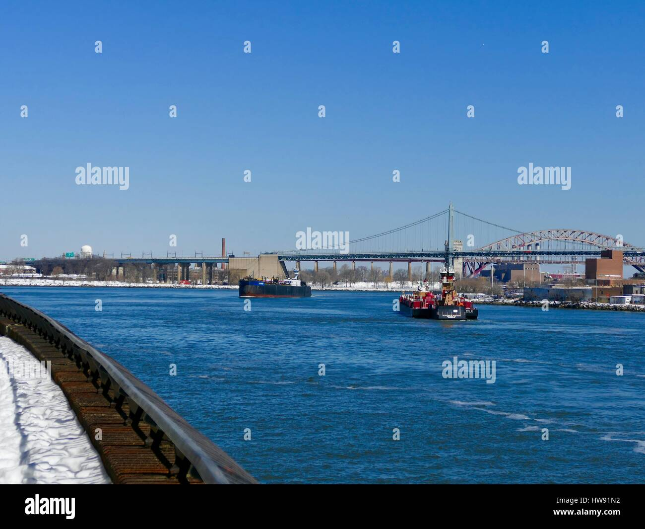 East River commercial boat traffic with RFK bridge in background. New York City, New York, USA - Stock Image