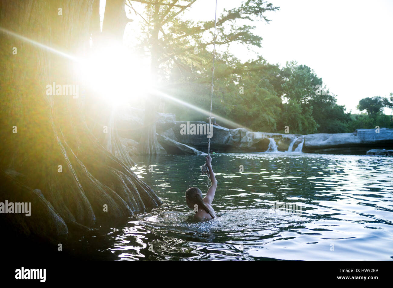 Rope swing at McKinney Falls in Texas - Stock Image