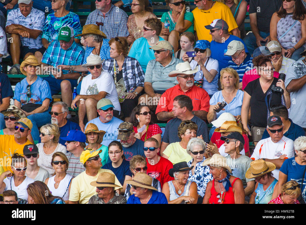 Crowd of people in bleachers at spectator sporting event - Stock Image