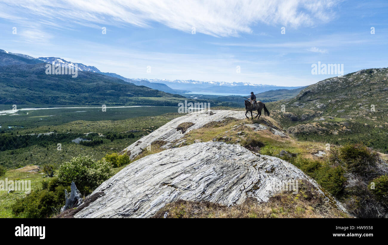 A Chilean gaucho on his horse, in Patagonia - Stock Image