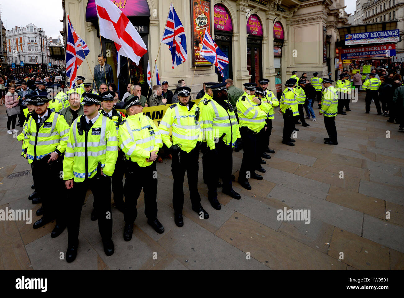 A demo took place in London on UN Anti Racism Day starting at Portland Place and ending in Parliament Sq.A group - Stock Image