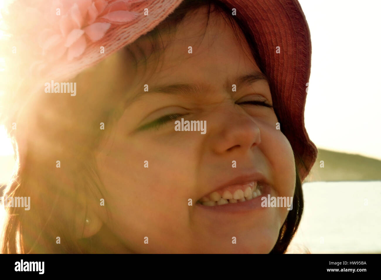 Funny face of a happy little girl - Stock Image