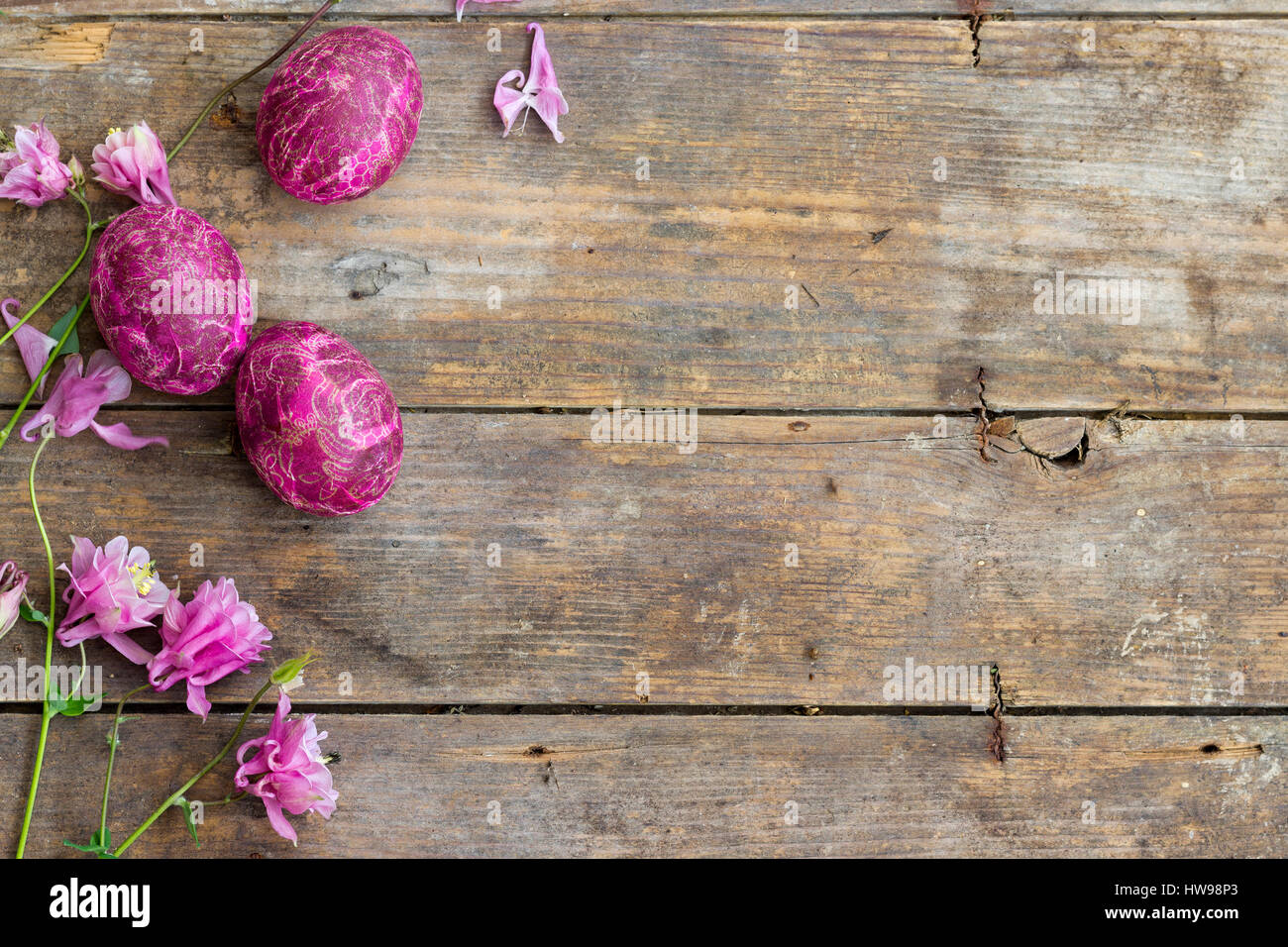 Decoupage decorated Easter eggs on a wooden table Stock Photo