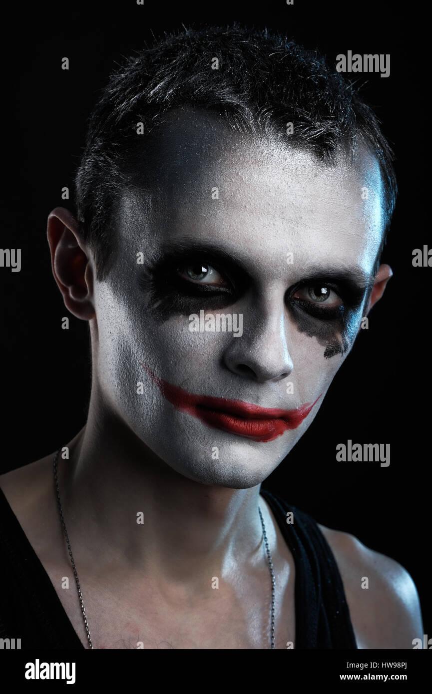 Spooky Man Joker On Black Background Stock Photo Alamy