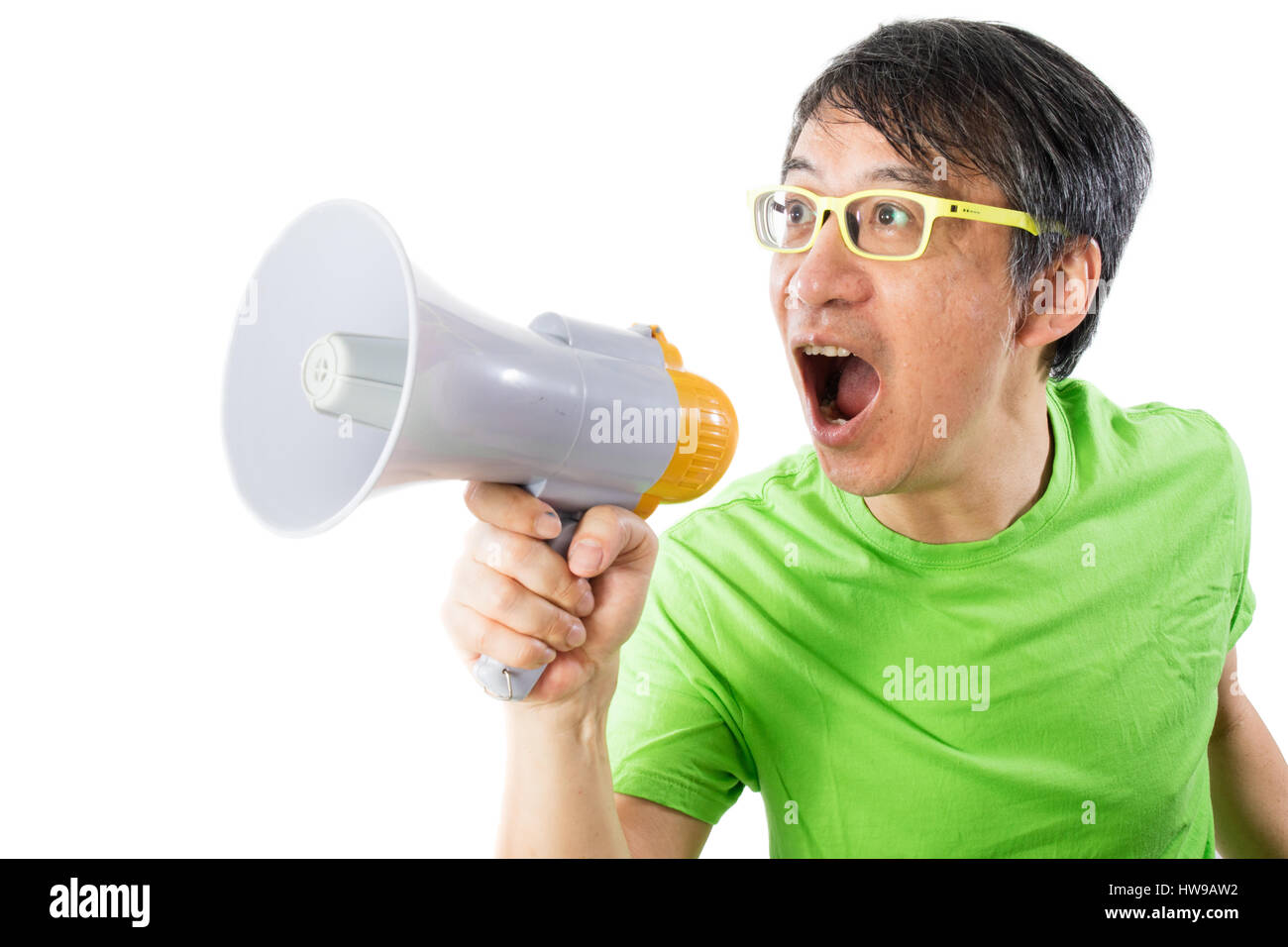 Asian Chinese Man Shouting with a Megaphone in isolated White Background - Stock Image
