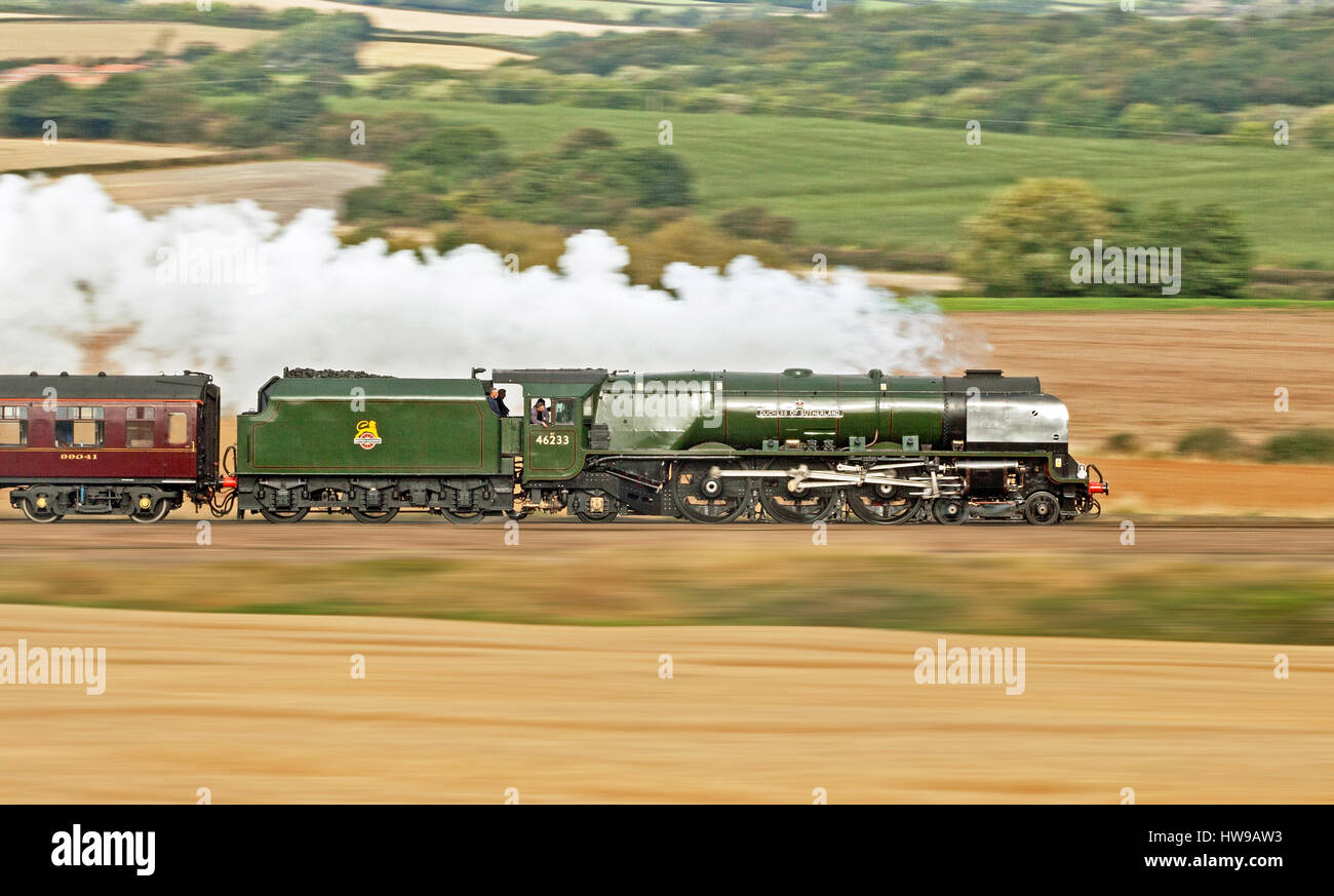 46233 Duchess of Sutherland makes good progress past Staveley with a Derby to Scarborough charter on 24 September - Stock Image