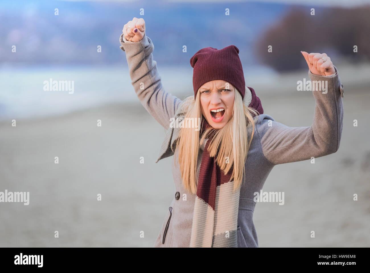 Young angry girl protesting - Stock Image