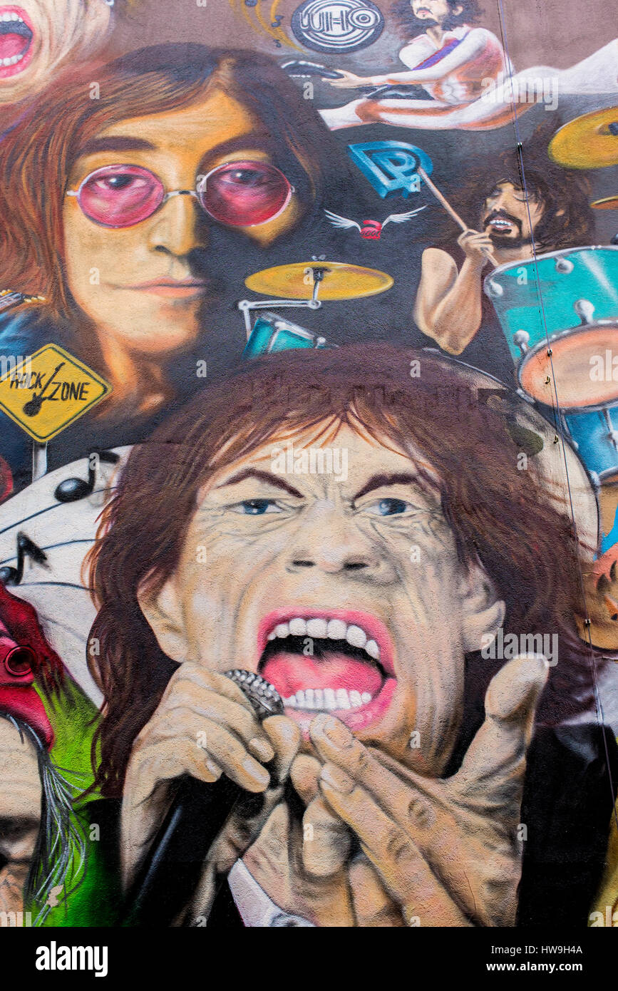 Graffiti with classic rock legends Mick Jagger and John Lennon in front of restaurant-bar 'L'Unique' - Stock Image