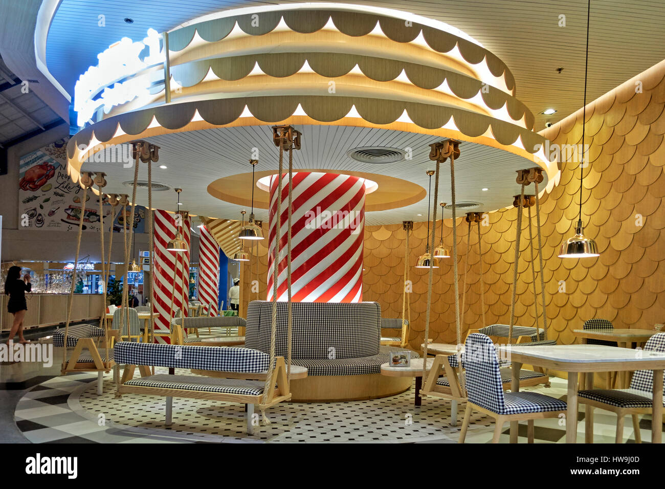 Unusual and imaginative rotund, carousel like, dining area in a Thailand Restaurant. - Stock Image