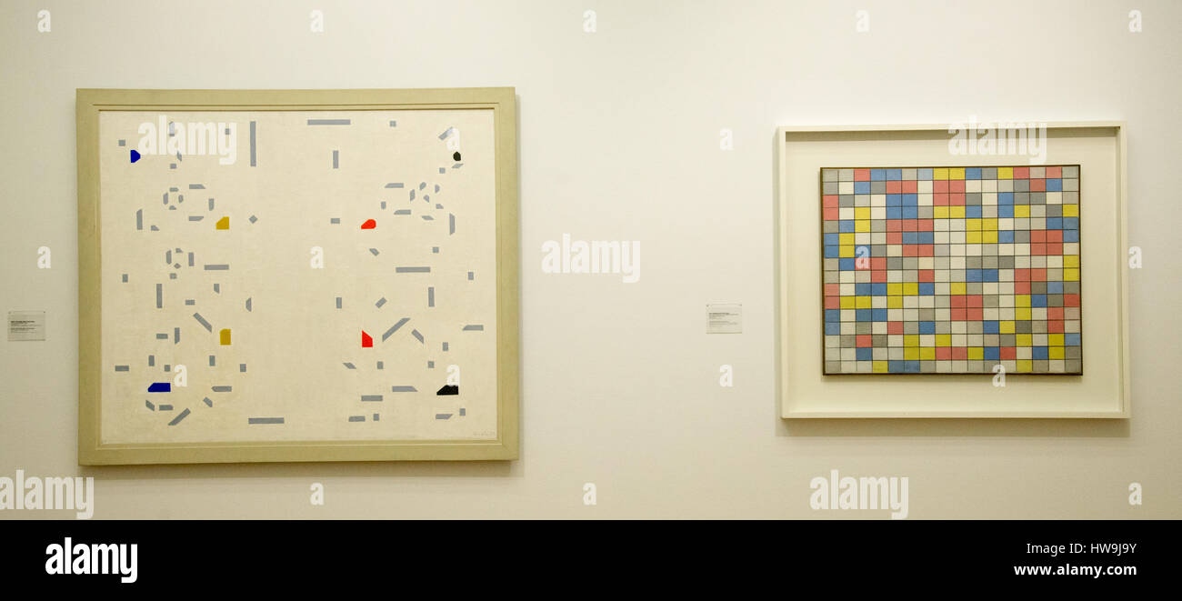 'the woodcutters' and 'composition with grid 9' from dutch painters van der leck and mondriaan - Stock Image