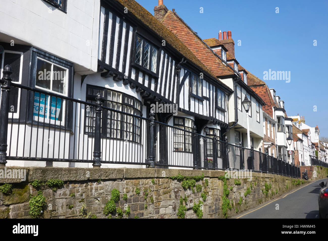 Hastings Old Town High Street, half timbered tudor houses on the raised pavement, East Sussex, England, Britain, - Stock Image