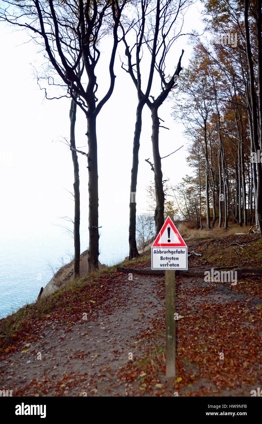 Warning sign, steep cliff,  Nationalpark Jasmund, Ruegen Island Stock Photo