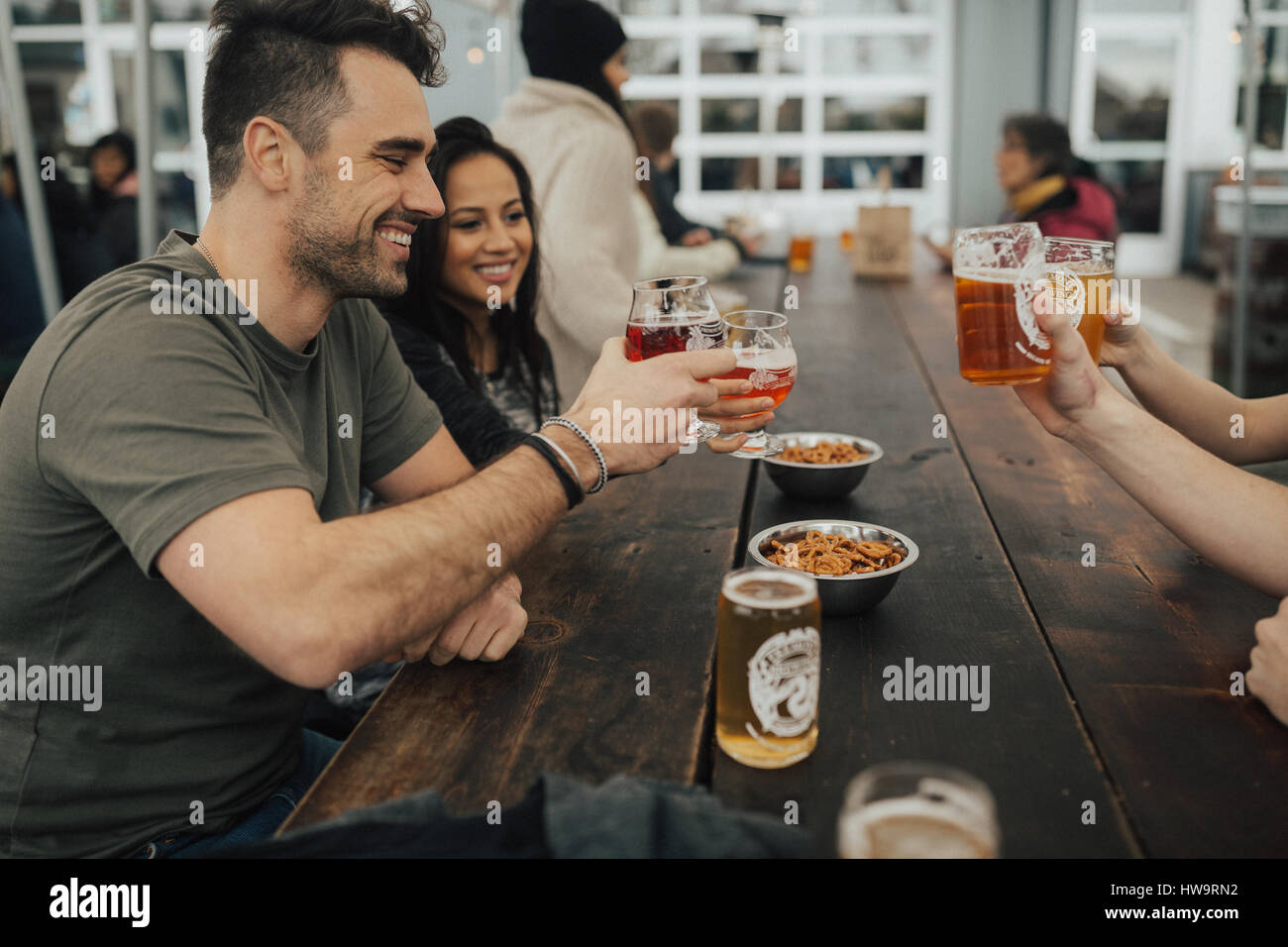 Cheers to a good beer and better friends - Stock Image