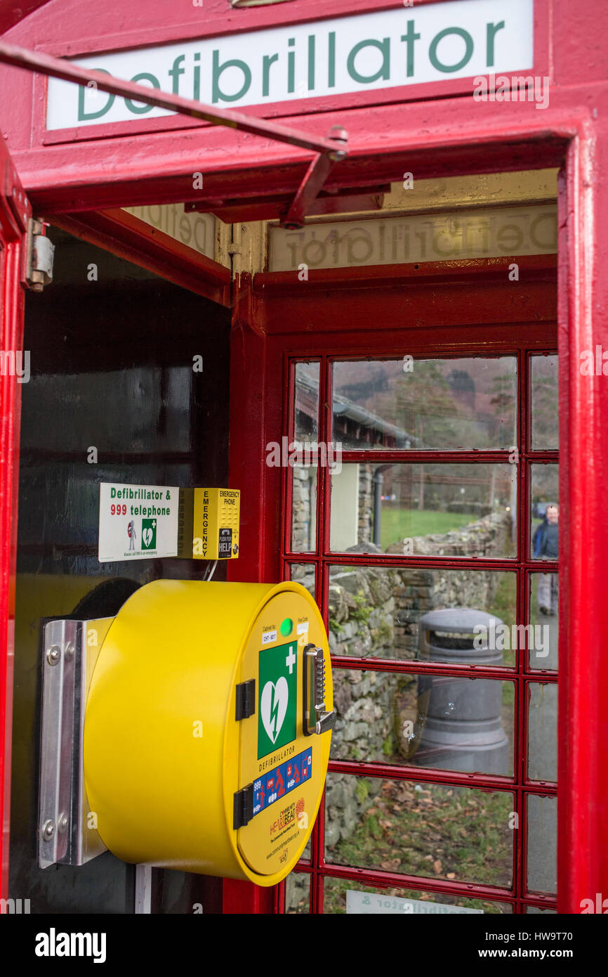 Defibrillator in a Red, traditional, Telephone Box in Grasmere, in the Lake District National Park - Stock Image