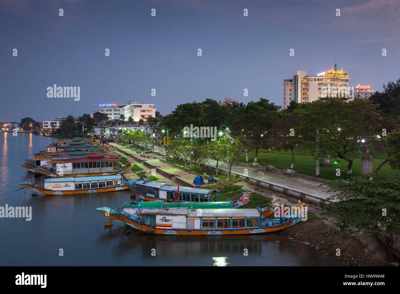 Vietnam, Hue, elevated view of Century Hotel, Perfume river and dragon boats, dusk Stock Photo