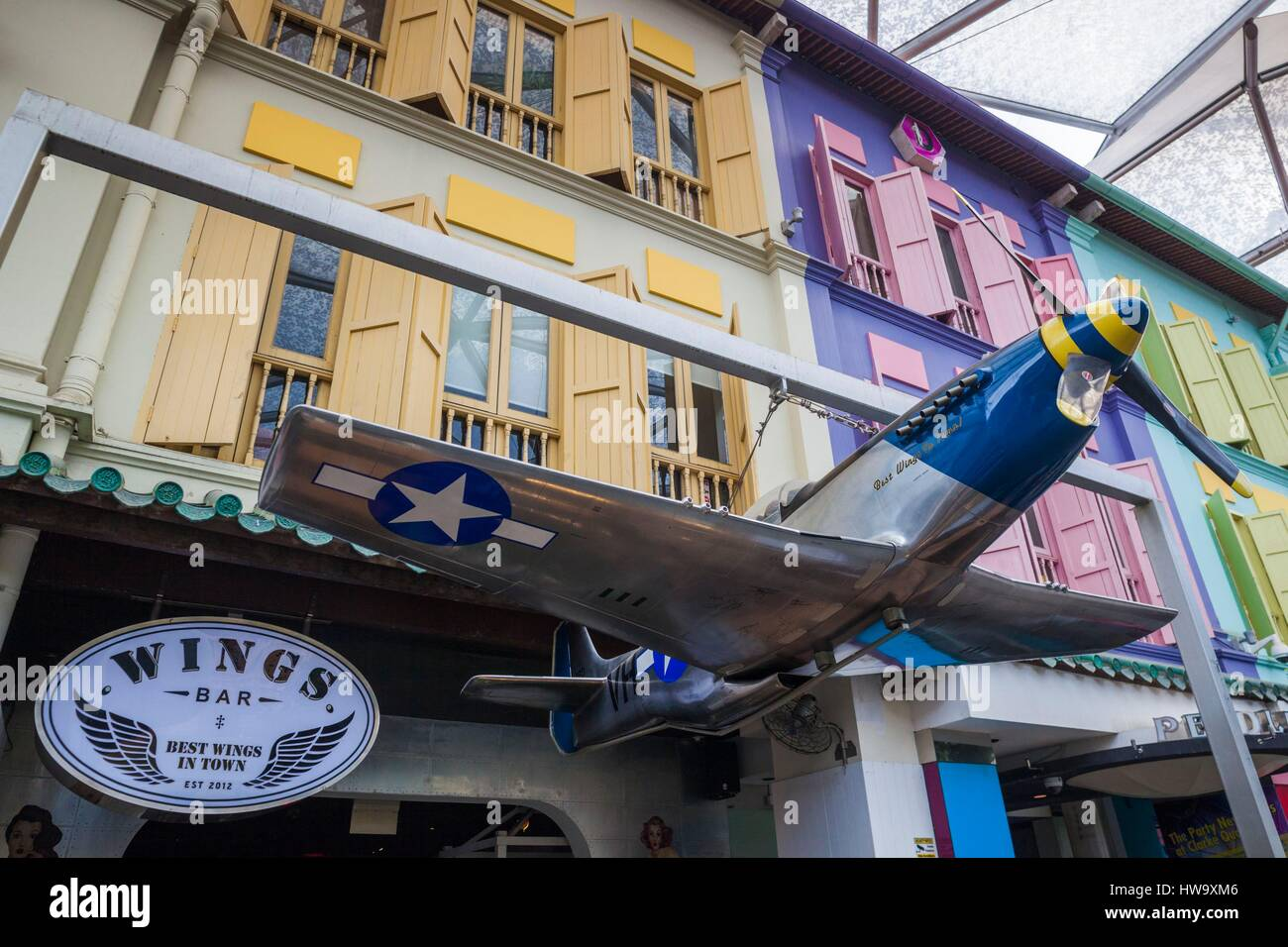 Singapore, Clarke Quay, entertainment district, Wings Bar with model of P-51 Mustang, WW2 aircraft Stock Photo