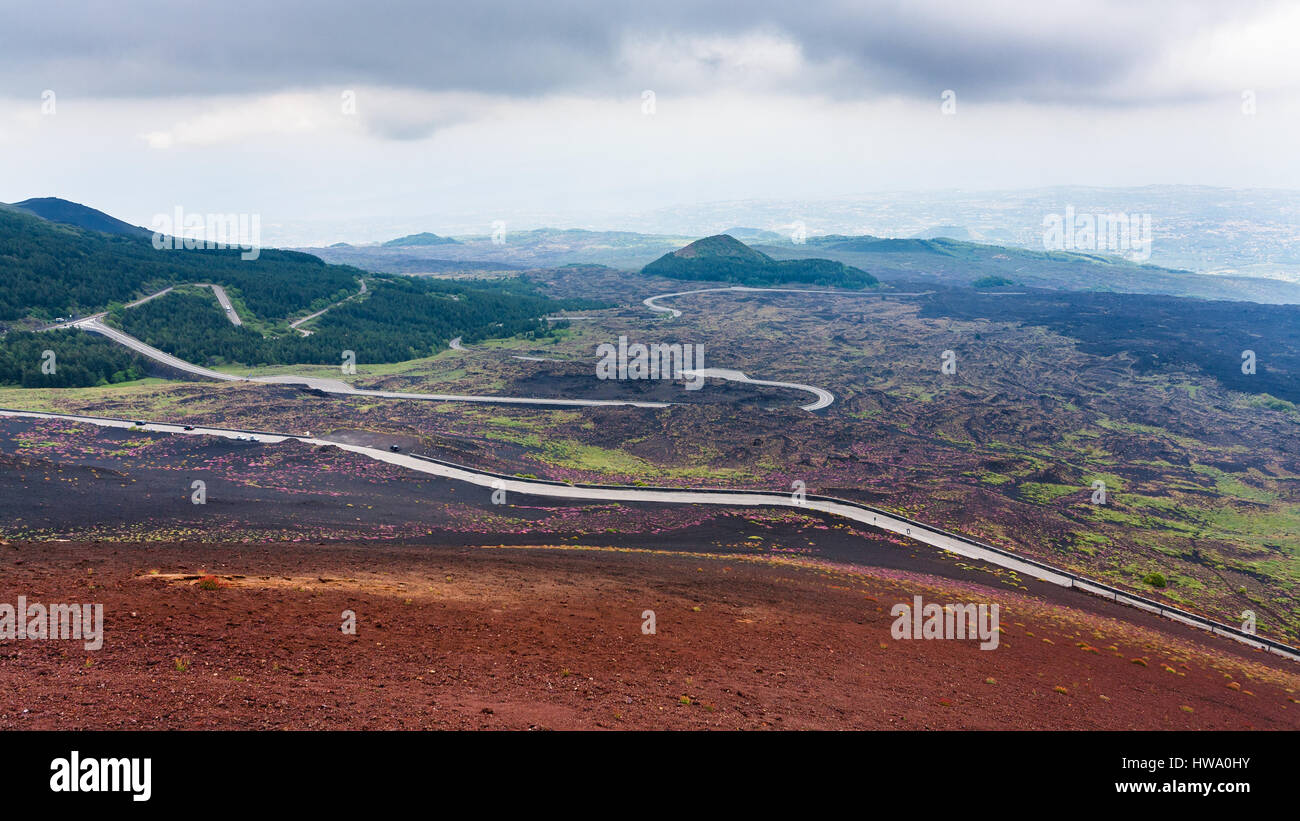 travel to Italy - road in hardened lava fields on Mount Etna in Sicily in summer day - Stock Image