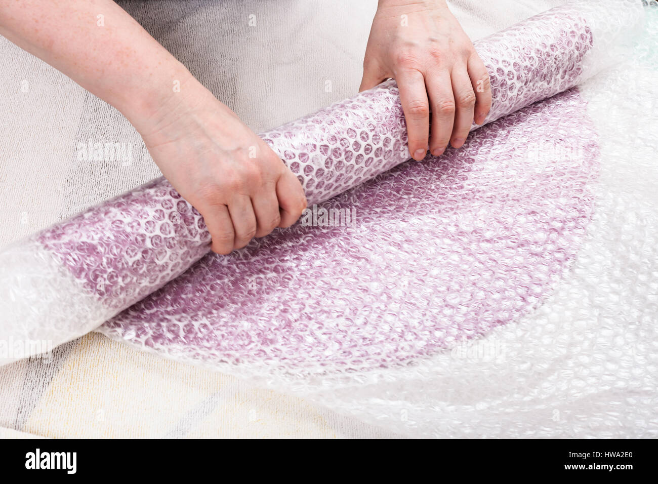 workshop of manufacturing of felt for beret in wet felting process - hatter rolls the wool fibers with hat layout - Stock Image