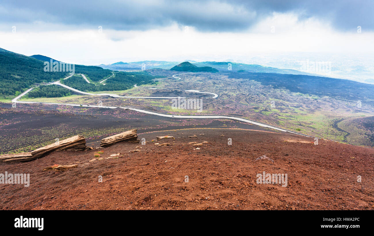 travel to Italy - road in frozen lava fields on Mount Etna in Sicily in summer day - Stock Image