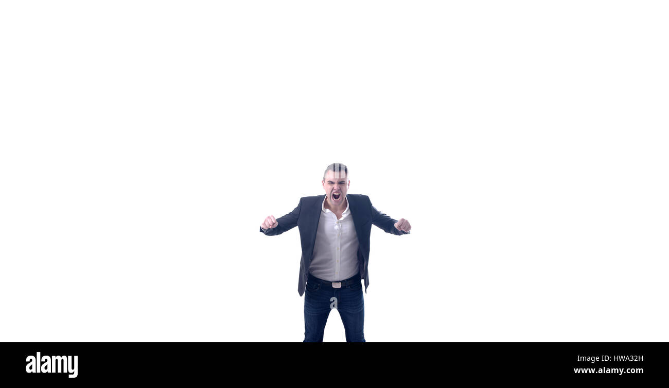 Very angry young businessman raging and screaming at camera. Huge white background,studio shot. - Stock Image