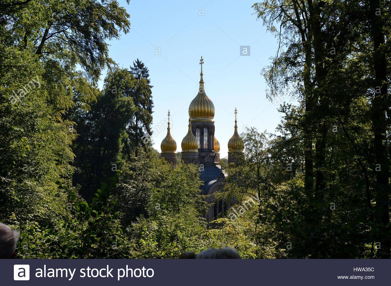 Russian Orthodox church among trees in Neroberg, Wiesbaden, Germany - Stock Image
