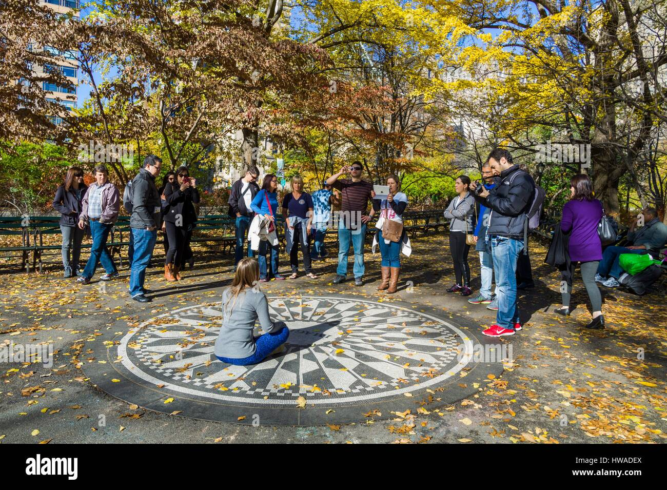 United States, New York, New York City, Central Park, John Lennon Memorial, Imagine, Strawberry Fields, with tourists - Stock Image