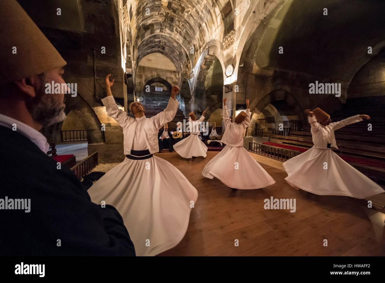 Turkey, Cappadocia, Avanos, whirling dervishes turn looking for mystical ecstasy in Seljuk caravanserai Sarihan - Stock Image