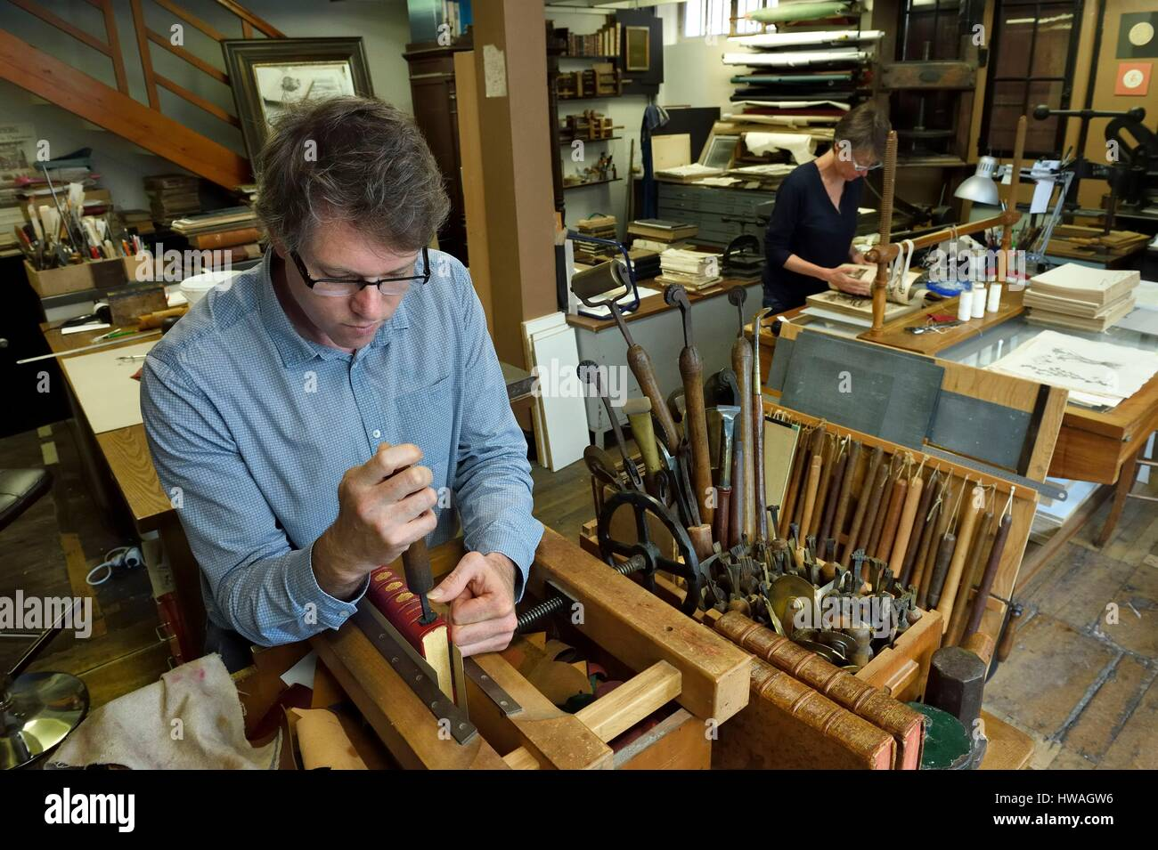 France, Dordogne, White Perigord, Perigueux, Christophe and Nathalie Legrand in their art bindery, foil and cardboard - Stock Image