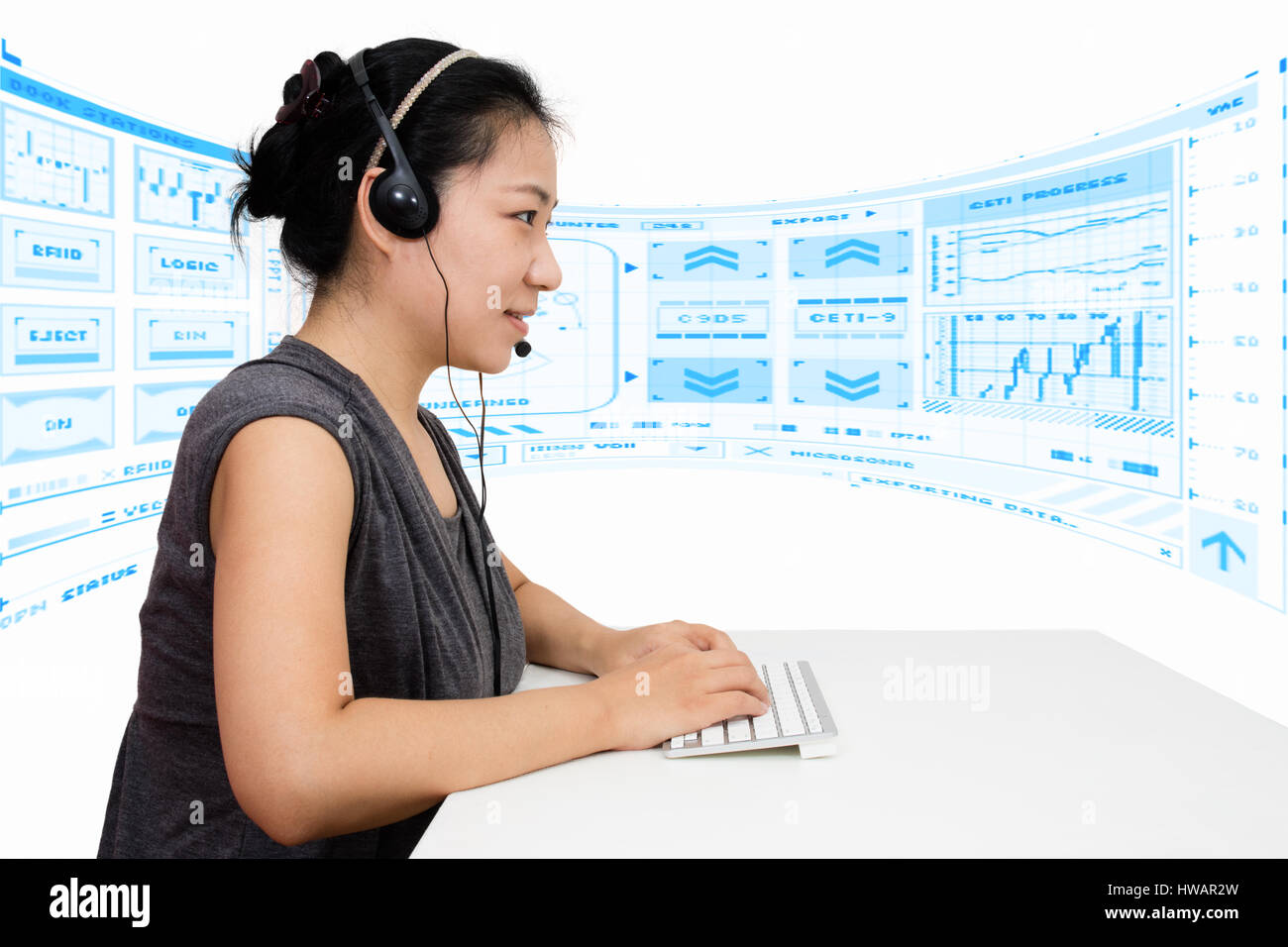 Asian Woman with Headset Using Keyboard in Isolated White Background Stock Photo
