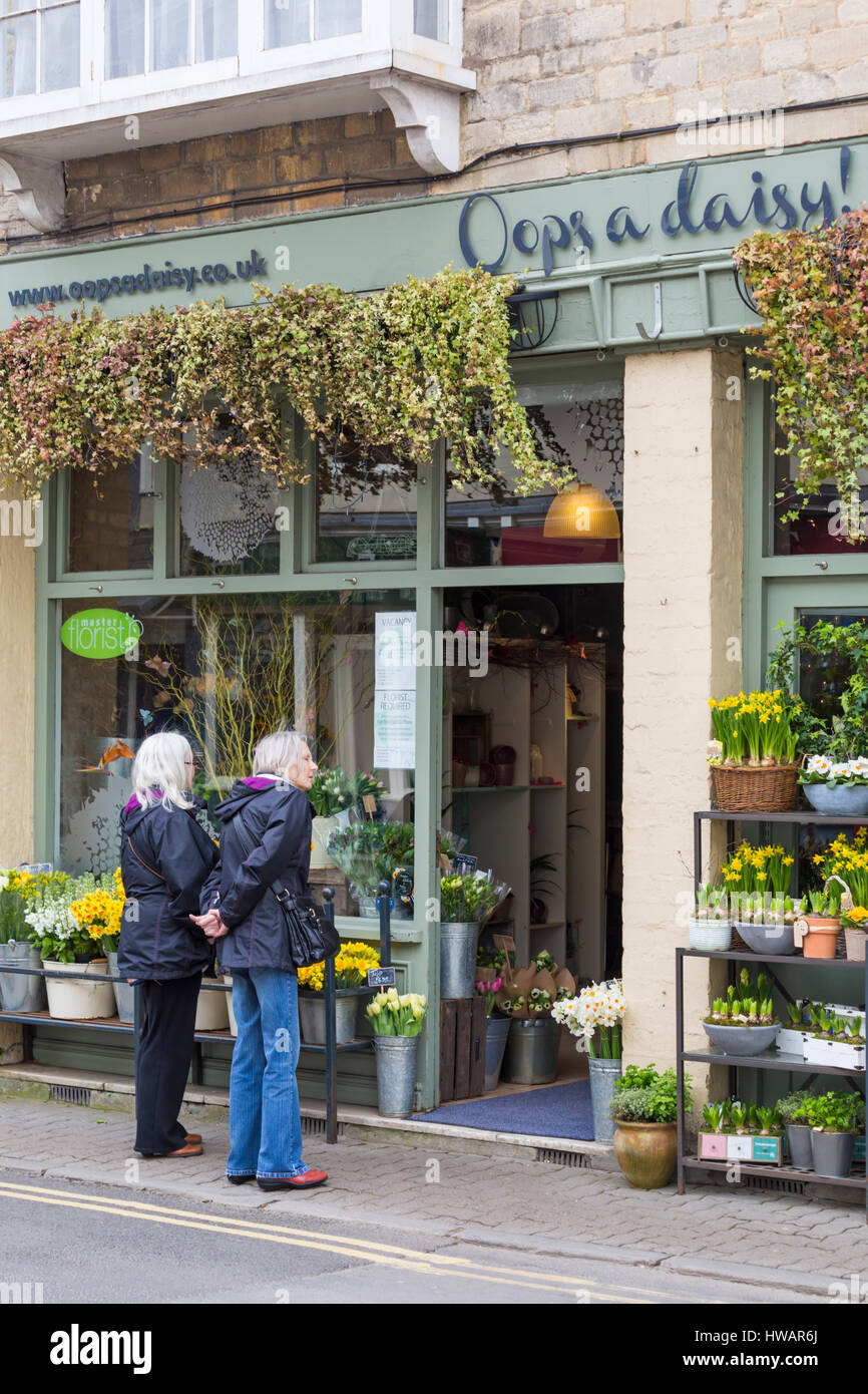 Oops a Daisy florist shop in Cirencester full of Spring flowers, ideal for Mothers Day, as couple of women look - Stock Image